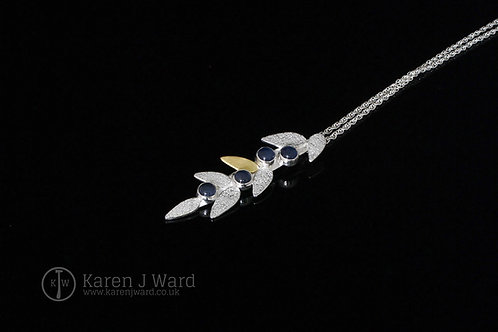 Sterling silver, 18k gold and sapphire pendant