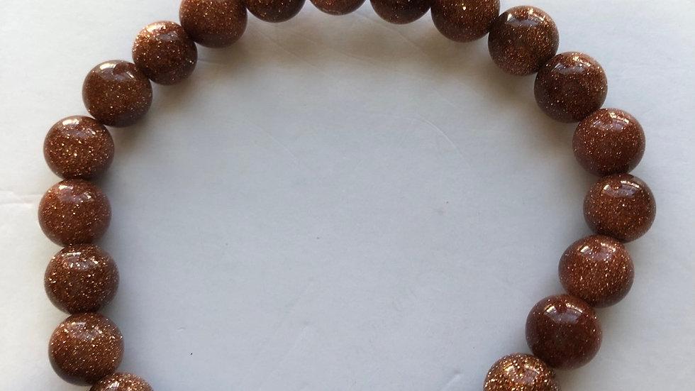 Goldstone beads stretch bracelet