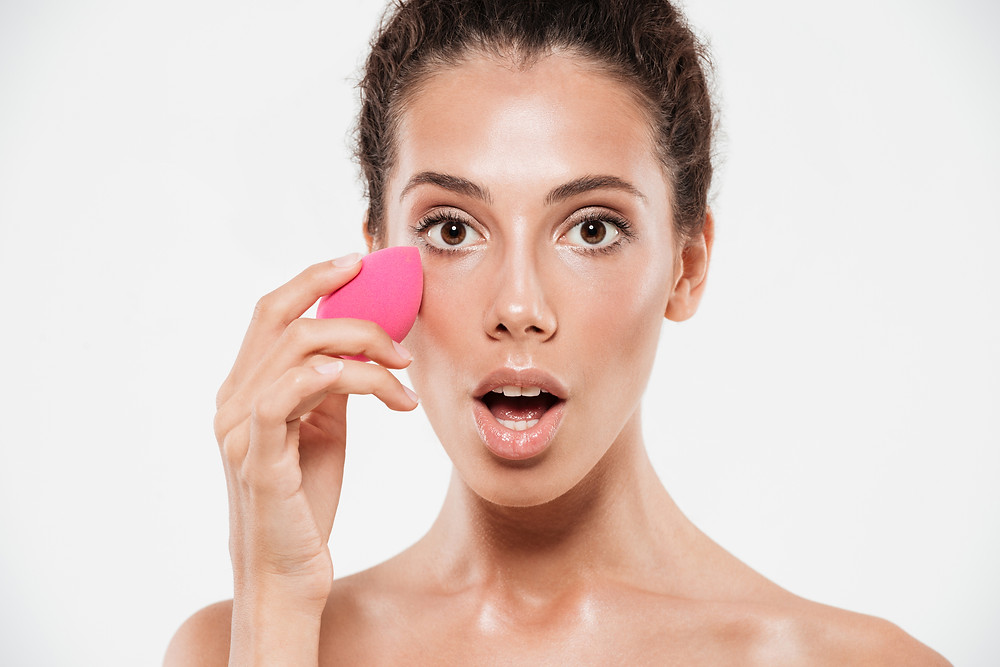 Woman loving her application using her new beauty sponge