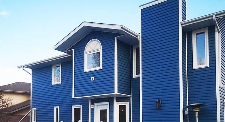 Siding of a house painted in royal blue.