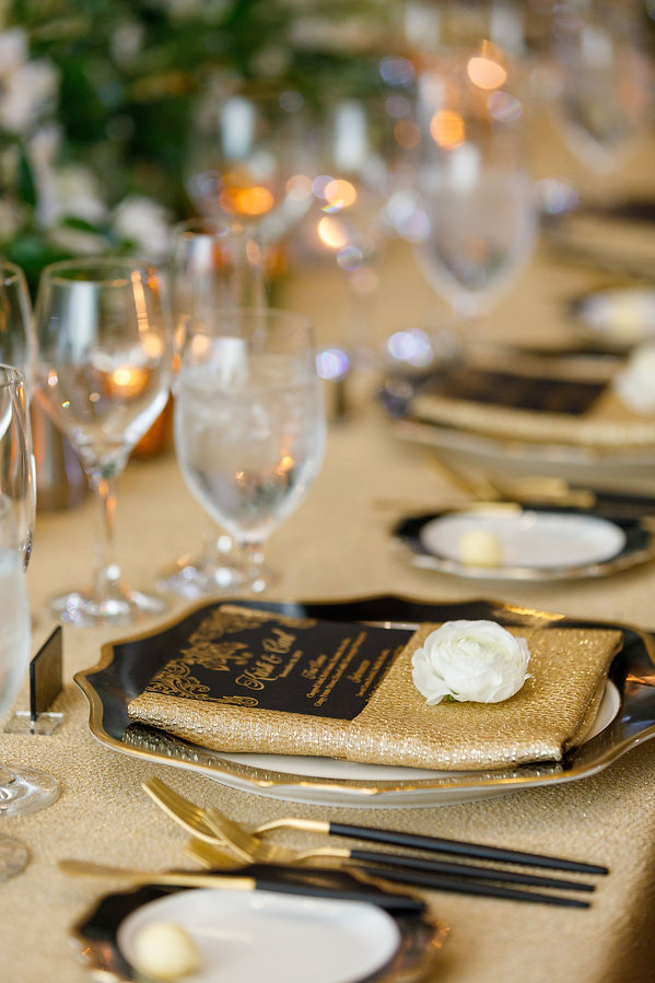 beautiful black and gold table setting