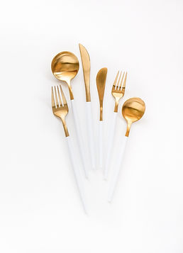 white and gold flatware