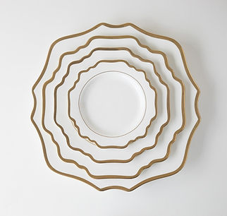 white and gold geometric plates