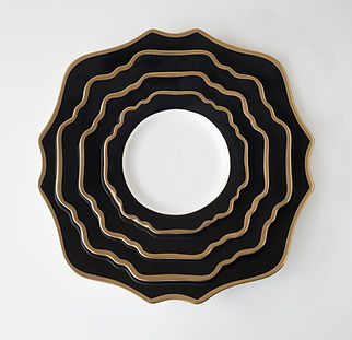 black and gold geometric plates
