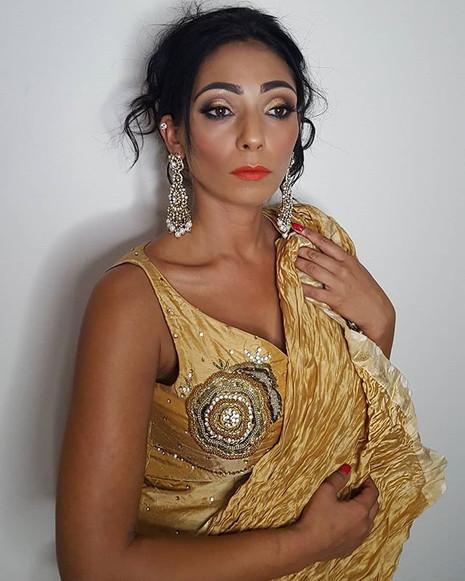 Sarika's gold cut crease makeup look. ._