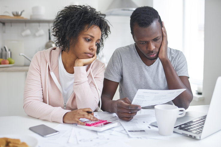 Stressed african american couple looking