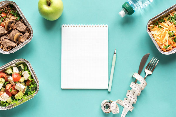 Nutrition Diet Plan flat lay with notebo