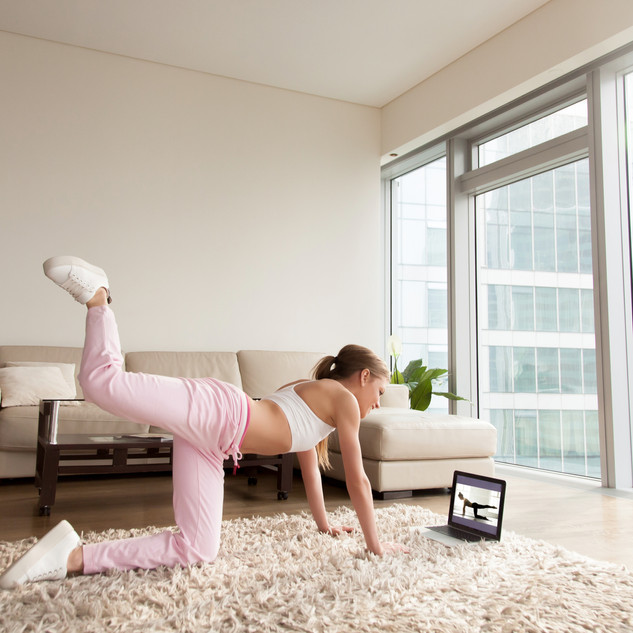 Young sporty woman working out at home,