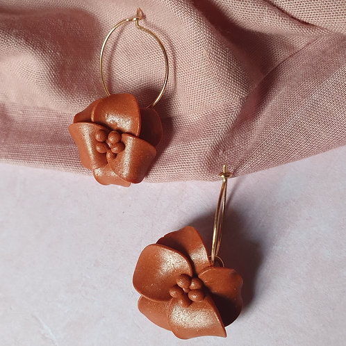 Shiny brown flower hoops