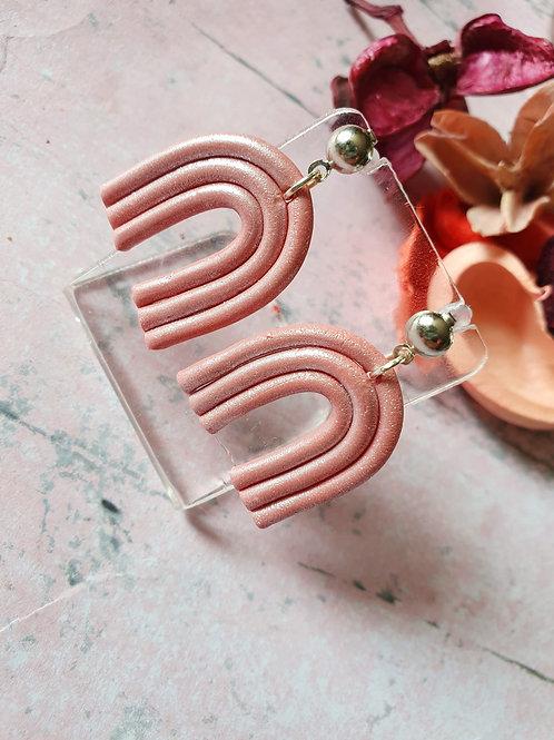 Medium arch pink pearl effect earrings