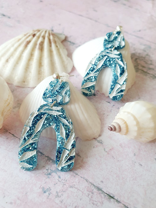 Blue floral arch dangle earrings