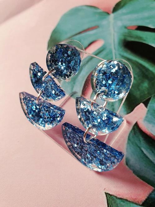 Delicate blue glitter dangles