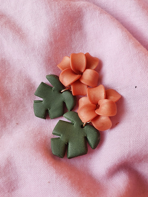 Peach flowers with monstera leaves dangles