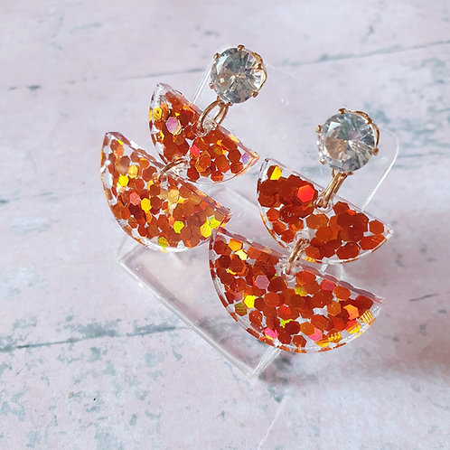Warm amber glitter dangles with sparkly gems