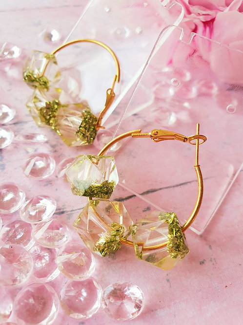 Green sparkles in beads on golden hoops
