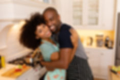 happy-young-couple-standing-in-the-kitch