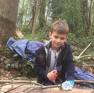 toddler group in the woods