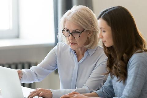Serious old female mentor teacher coach
