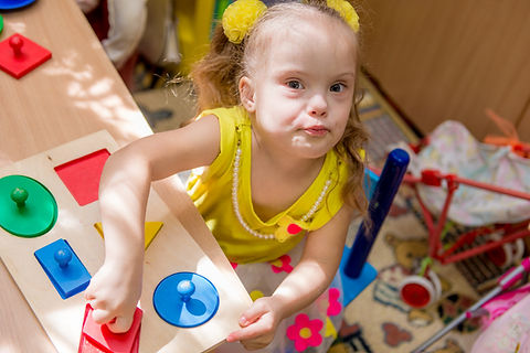 Girl with down syndrom developing motor