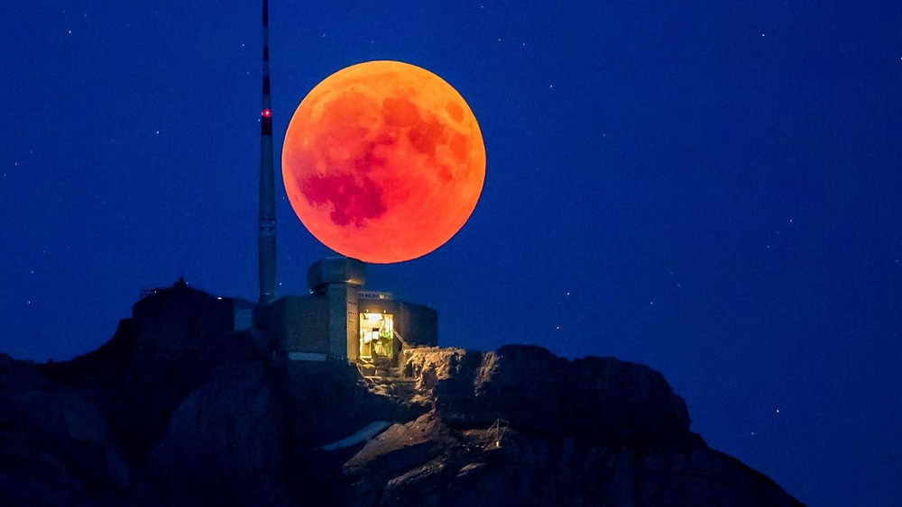 night time sky with a full blood moon