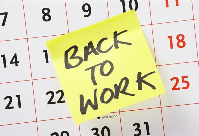 Sticky Note that says 'Back To Work' on a calendar