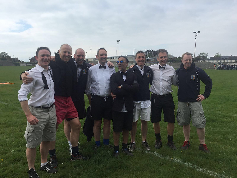 Scott McIness with teammates on adult mens rugby team