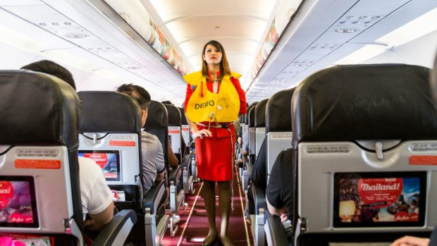 airline stewardess explaining safety procedures before a flight