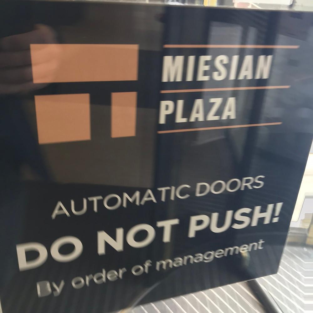 """warning sign; """"DO NOT PUSH!"""""""