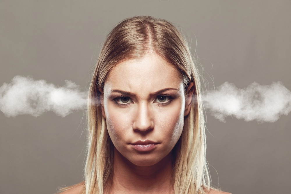 Frustrated woman with steam coming out of her ears