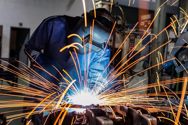 welder is welding metal part in car fact