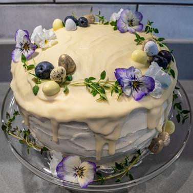 kates kakes white chocolate easter drip cake with edible flowers