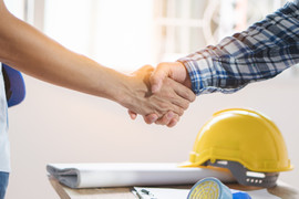 Architect contractor shaking hands with