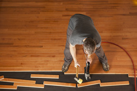 Top view of a man installing planks of h