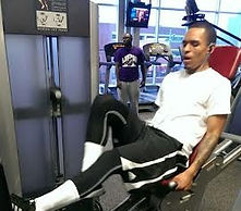 C.A.A.N. man training in gym on bike