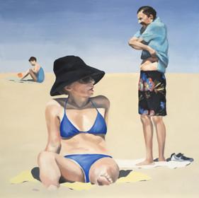 Beachgoers in Black and Blue