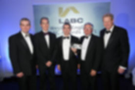 Shaun Galvin (centre) receiving the LABC West of England Award 'Best Housing – large developer/development' category 2011