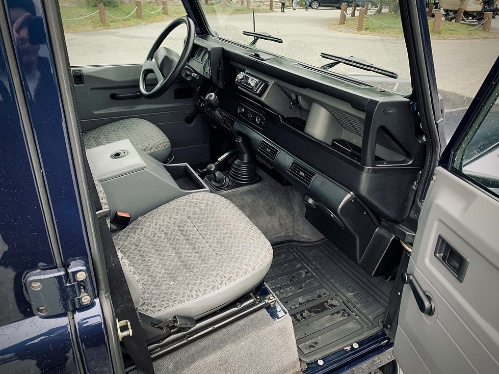 Blue Defender 110 interior front.jpg