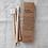 4本の竹製歯ブラシと紙製のパッケージ