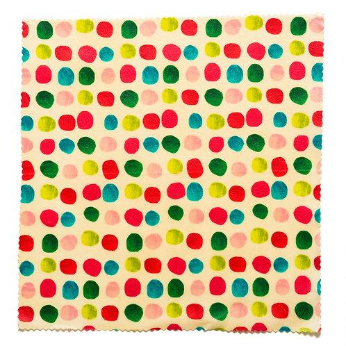 明るい色の沢山の歪な円の模様のみつろうラップ