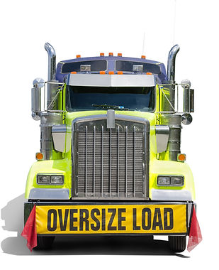 A big semi tractor 18 wheel truck with a big OVERSIZE LOAD banner and red flags on the front of the