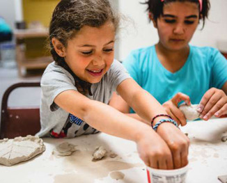 Kids doing pottery at san francisco pott