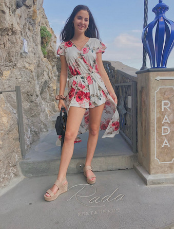 Taylor posing in front of Rada in Positano, Italy