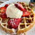 Waffles with strawberries and sugar