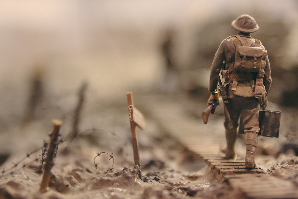 Soldier walking over railway tracks during D-Day Worldwide Breaking News