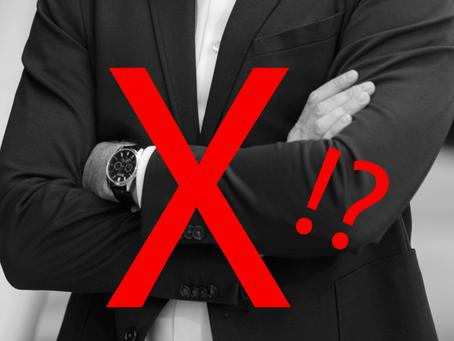 Ar galima verslo portrete kryžiuoti rankas?