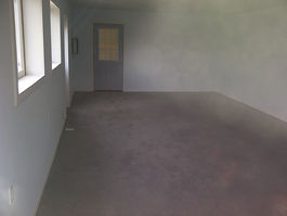 stained concrete floor after slab jacking