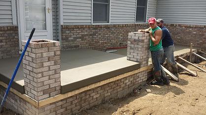 front porch concrete with brick pillars