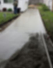 concrete driveway with drainage channel