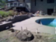 concrete pool deck with retaining wall