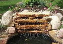 water feature pondles waterfall seating wall landscaping garden hydro seeding landscape design